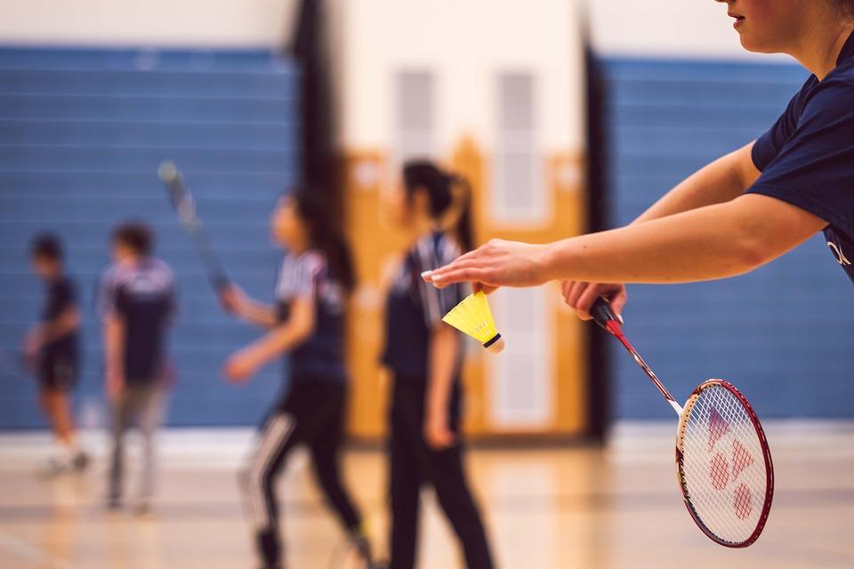 man serving to start the badminton game